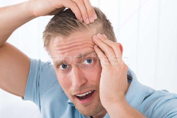 Man Examining His Hair Stock photo © AndreyPopov