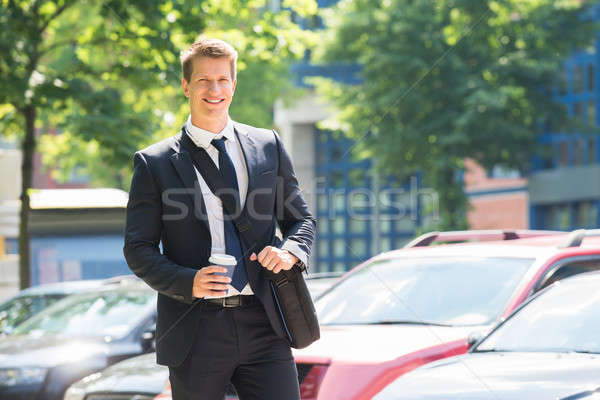 Young Businessman With Disposal Cup Stock photo © AndreyPopov