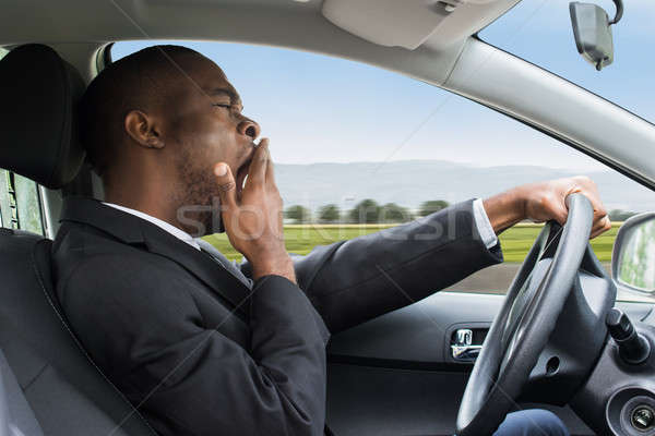 Stockfoto: Zakenman · rijden · auto · zijaanzicht · jonge