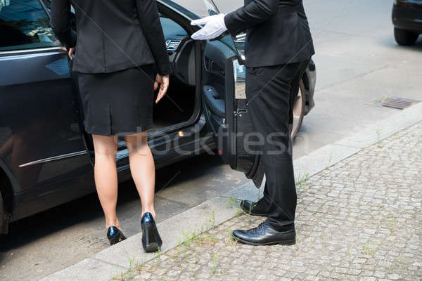 Male Chauffeur Opening The Car Door Stock photo © AndreyPopov