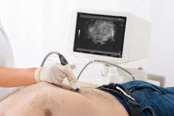 Médecins main ultrasons scanner abdomen Homme Photo stock © AndreyPopov