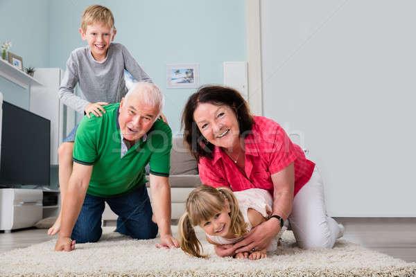 Portrait Of Multi Generation Family Lying On Carpet Stock photo © AndreyPopov