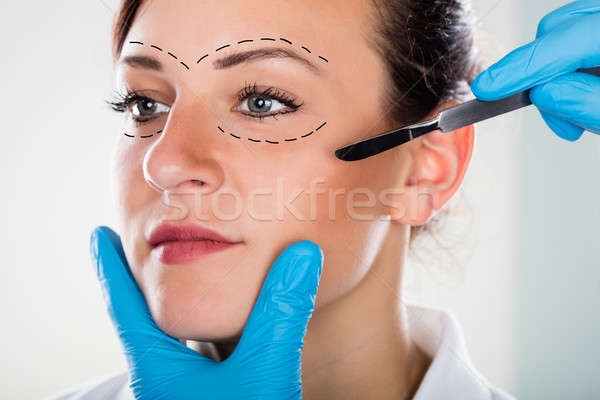 Cosmetic Face Surgery With Scalpel Stock photo © AndreyPopov