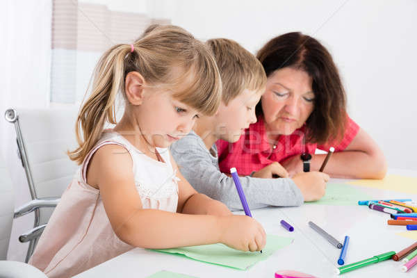 Grandchildren Drawing On Colorful Paper At Home Stock photo © AndreyPopov