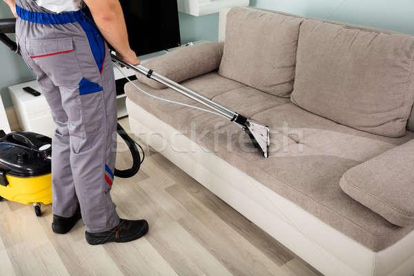 мужчины работник очистки диван пылесос вид сзади Сток-фото © AndreyPopov