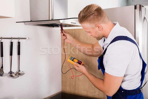 техник кухне молодые мужчины цифровой Сток-фото © AndreyPopov