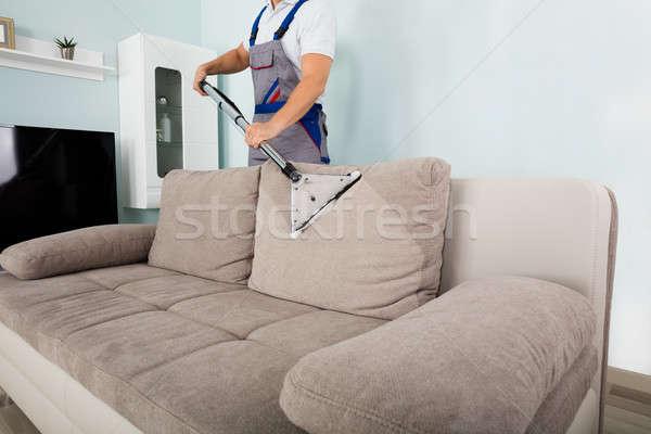 мужчины работник очистки диван пылесос молодые Сток-фото © AndreyPopov