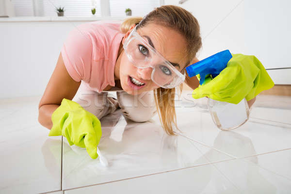 Frustrated Woman Cleaning Floor With Brush Stock photo © AndreyPopov