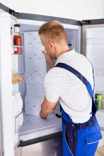 Repairman Fixing Refrigerator Stock photo © AndreyPopov