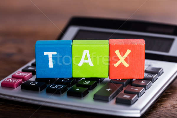 Blocks With Word Tax Placed Over Calculator Stock photo © AndreyPopov