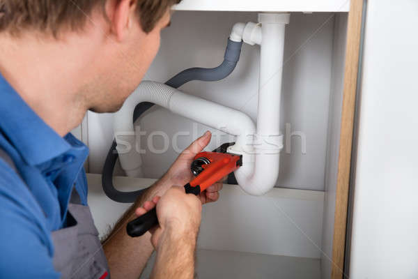Male Plumber Fixing Sink Pipe Stock photo © AndreyPopov