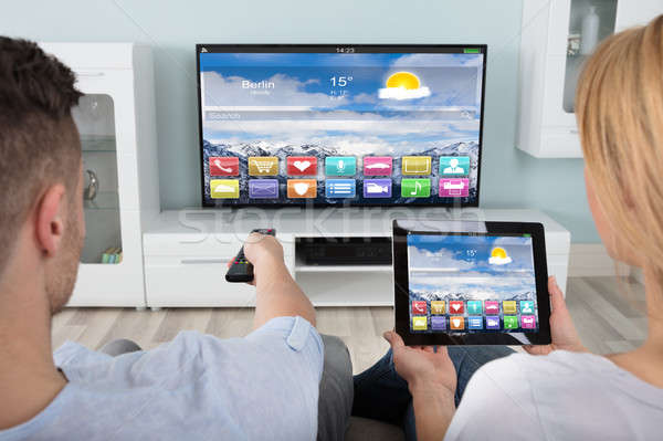 Couple Watching Television Using Digital Tablet Stock photo © AndreyPopov