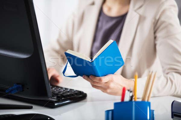 Stock photo: Businesswoman Holding Diary