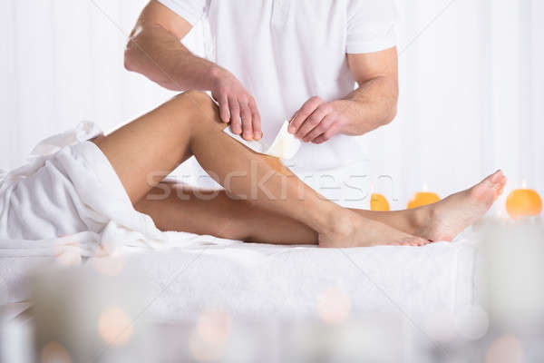 Woman Waxing In Beauty Spa Stock photo © AndreyPopov