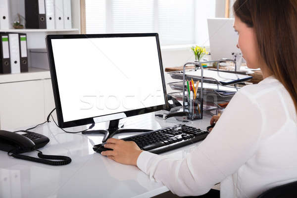 Businesswoman Working On Computer Stock photo © AndreyPopov