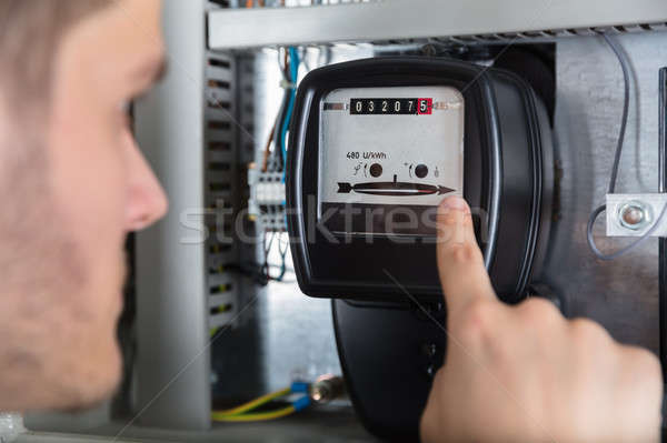 Man Pointing At Electric Meter Stock photo © AndreyPopov