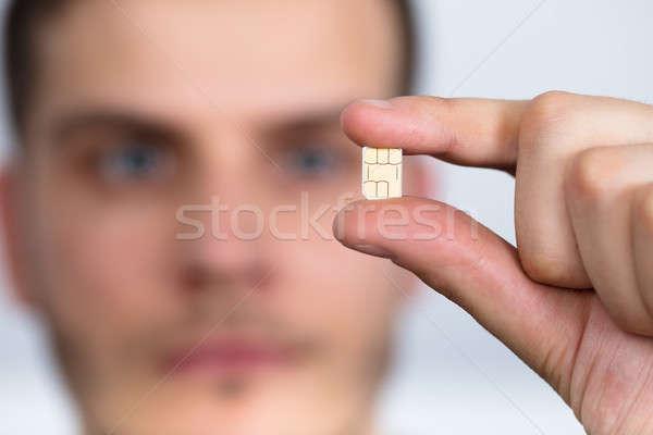 Homem nano cartão mão Foto stock © AndreyPopov