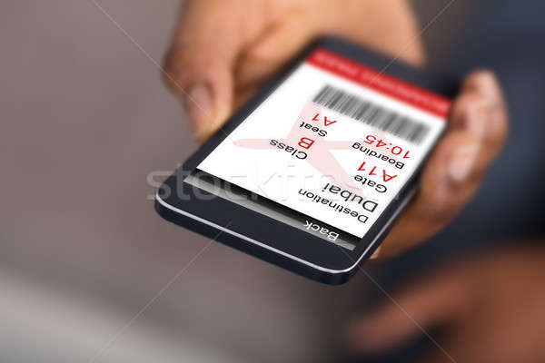 Human Hand Holding Mobile Phone With Electronic Boarding Pass Stock photo © AndreyPopov