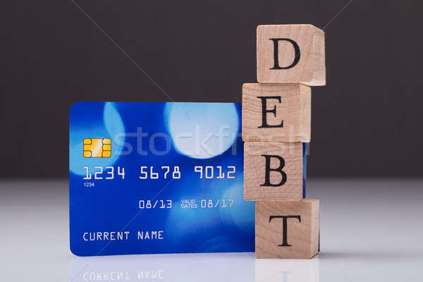 Debt Card And Debt Word On Wooden Block Stock photo © AndreyPopov