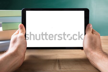 Human Hand With Digital Tablet Showing Blank White Screen Stock photo © AndreyPopov