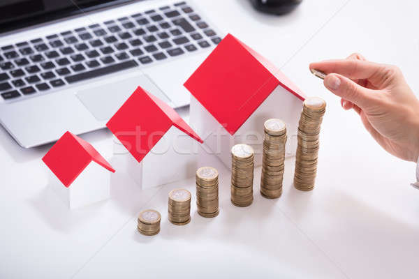 Businessperson's Hand Stacking Coins Stock photo © AndreyPopov