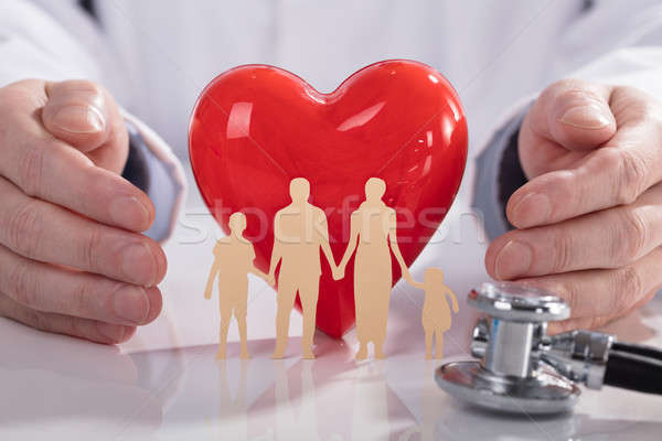 Doctor Protecting Red Heart And Family Paper Cut Out Stock photo © AndreyPopov