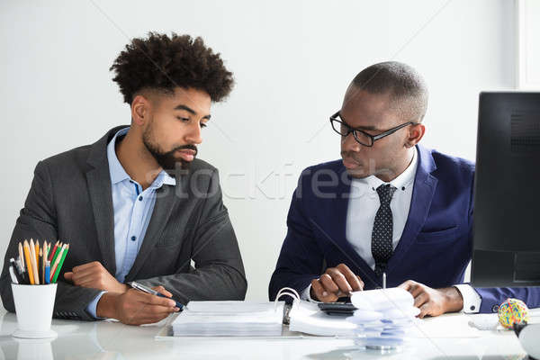 Business Colleagues Calculating Tax Stock photo © AndreyPopov