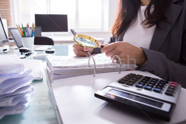Businesswoman Checking Bill Through Magnifying Glass Stock photo © AndreyPopov