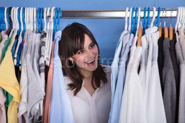 женщину глядя разнообразие одежды счастливым Сток-фото © AndreyPopov