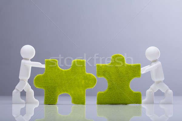 Due miniatura umani verde vista laterale Foto d'archivio © AndreyPopov