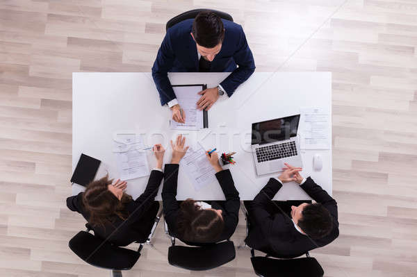 Businesspeople Interviewing Male Candidate Stock photo © AndreyPopov