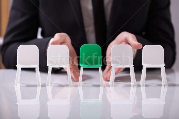 Empresário oferta verde assento branco cadeiras Foto stock © AndreyPopov
