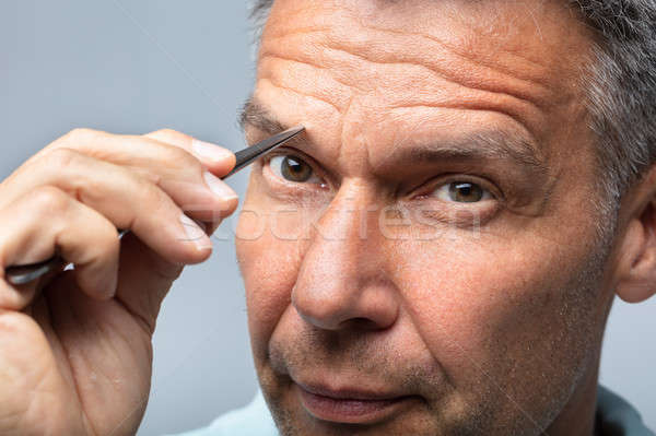 Man Plucking Eyebrow Hair Stock photo © AndreyPopov