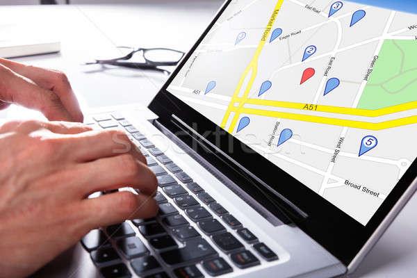 Személy GPS térkép laptop navigáció kéz Stock fotó © AndreyPopov