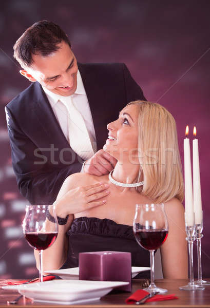 Homme collier femme restaurant heureux Photo stock © AndreyPopov