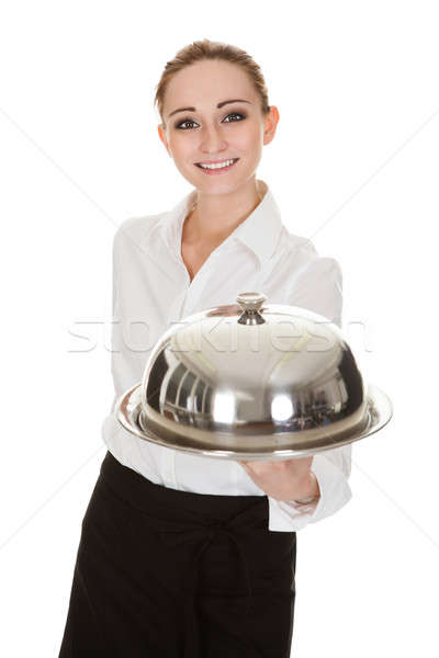 Young Waitress Holding Tray And Lid Stock photo © AndreyPopov