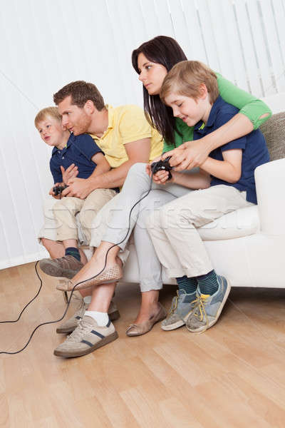 Young family playing videogames Stock photo © AndreyPopov