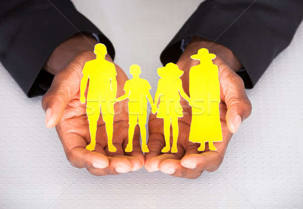 Male Hand Holding Family Cutout Shape Stock photo © AndreyPopov