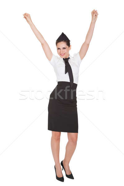 Woman with arms raised in jubilation Stock photo © AndreyPopov