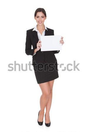 üzletasszony tart plakát boldog mosolyog fiatal Stock fotó © AndreyPopov