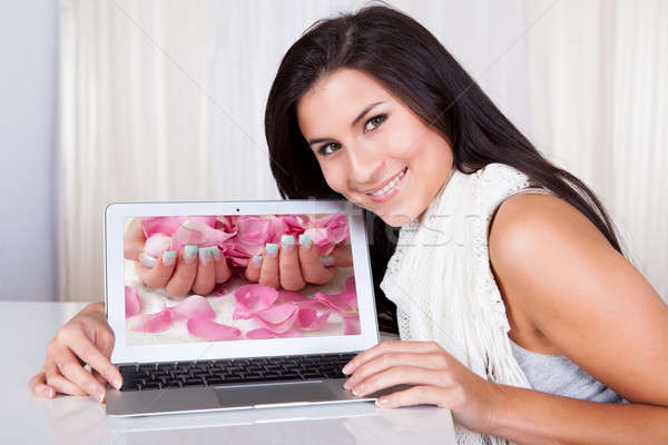 Happy woman looking for fingernail designs Stock photo © AndreyPopov