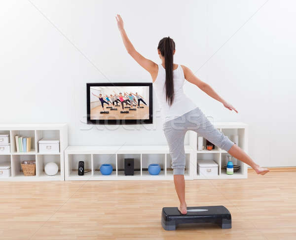 Athletic woman doing home exercises Stock photo © AndreyPopov