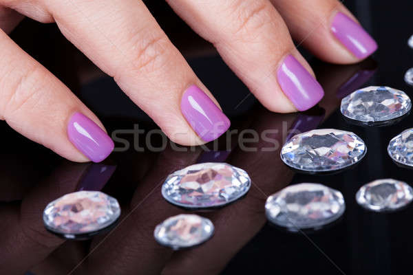 Close-up Of Fingernails And Diamonds Stock photo © AndreyPopov