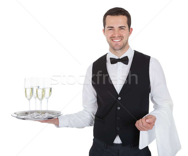 Portrait of a cheerful young butler Stock photo © AndreyPopov