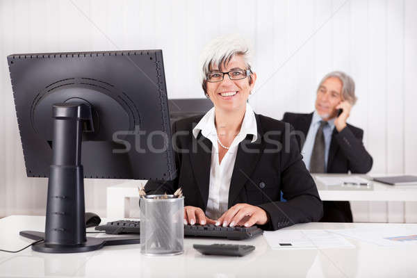 Smiling secretary or personal assistant Stock photo © AndreyPopov