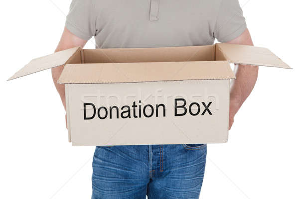 Man holding donation box Stock photo © AndreyPopov