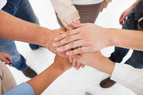 Businesspeople Stacking Hands Stock photo © AndreyPopov
