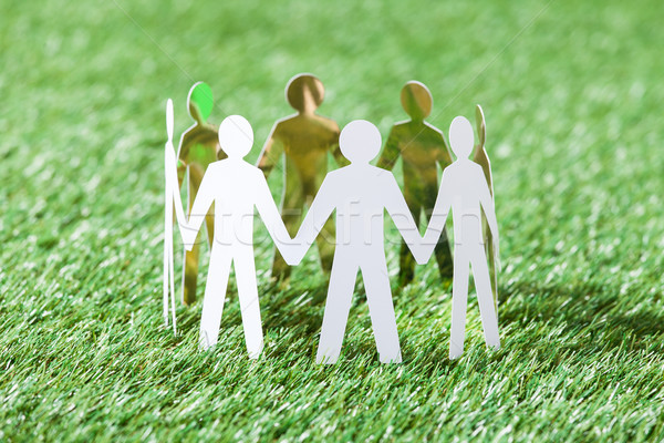 Team Of Paper People On Grassy Field Stock photo © AndreyPopov