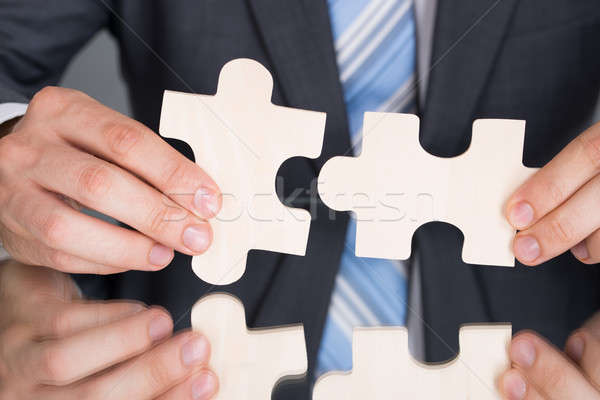Hands connecting puzzle pices Stock photo © AndreyPopov