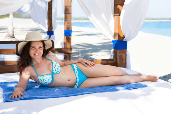 Woman Relaxing In Gazebo At Beach Stock photo © AndreyPopov